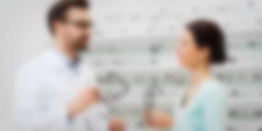 An optometrist speaking with a patient